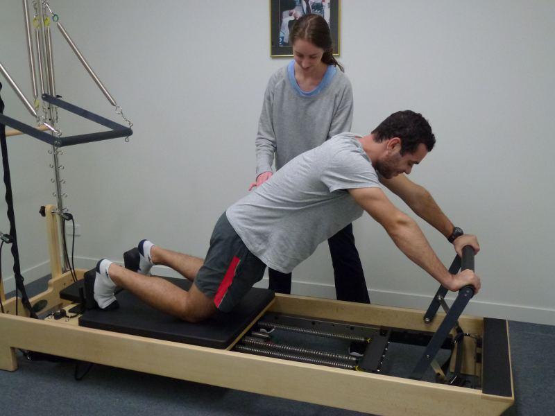 Jess treating Matthew Kaye with Pilates, former AJAX Senior Footballer (VAFA B League)