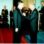Ross Smith receives the Order of Australia Medal from the Governor