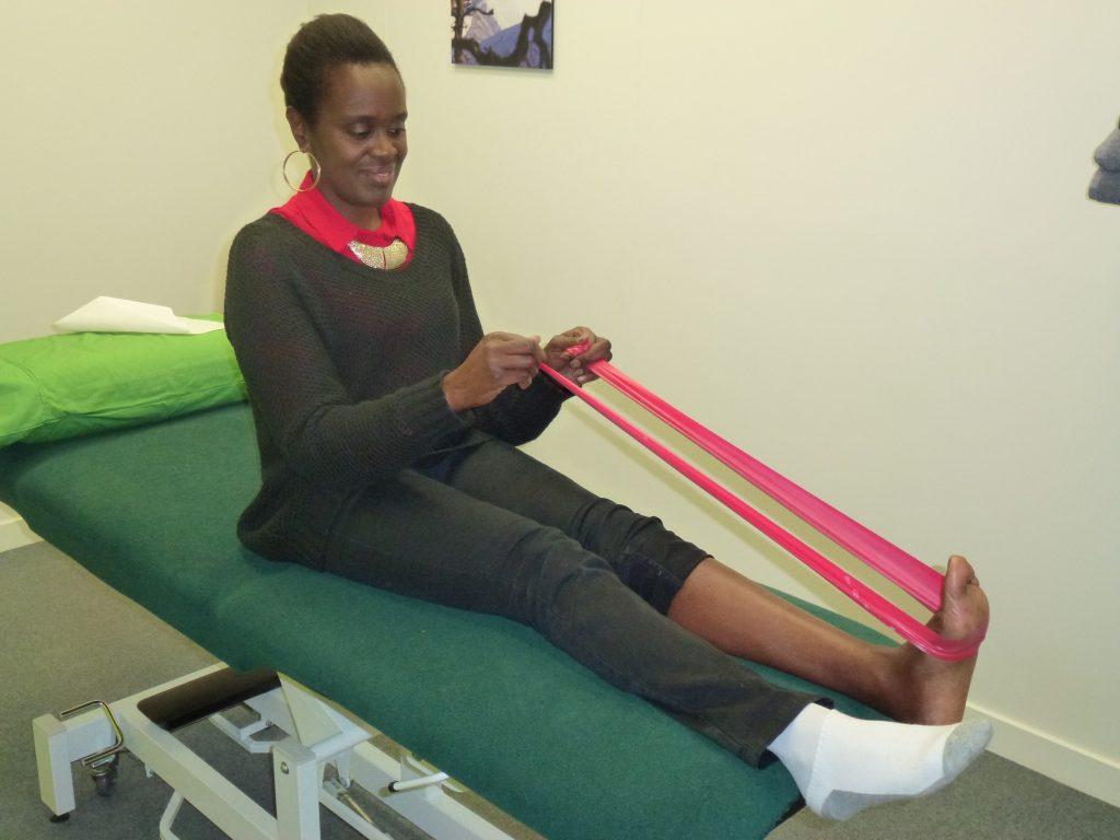 An elite netballer stretching and strengthening her achilles tendon.